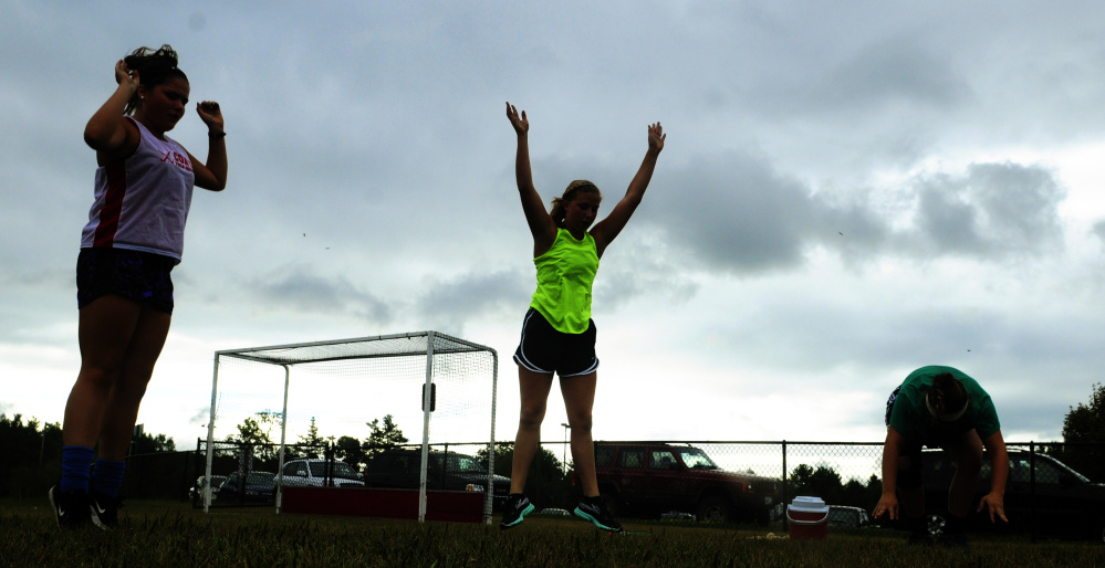 Cony High field hockey players stretch during an Aug. 17 practice in Augusta.