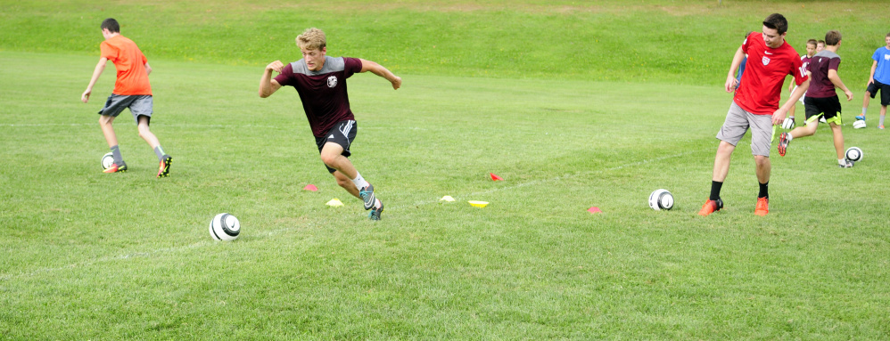 Members of the Monmouth boys soccer team run during an Aug. 16 practice  in Monmouth. The Mustangs return a talented team that once again should challenge for the Class C South title.