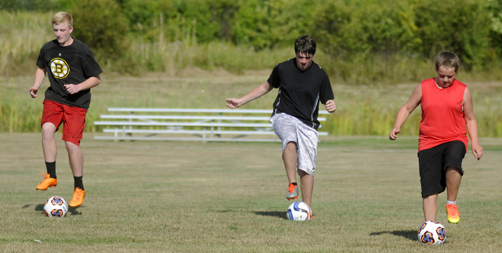 Members of the Richmond boys soccer team work through some drills during an Aug. 18 practice in Richmond.