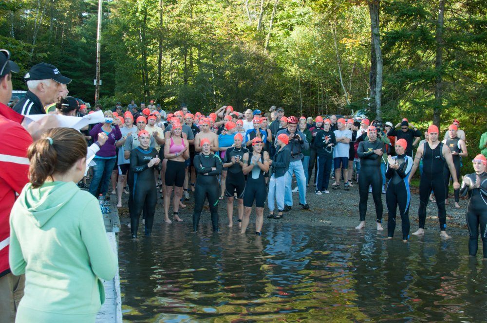 Athletes gather on the east side of Lake George Regional Park for the swimming portion of the 2013 triathlon, an annual fundraiser for the park that will be held Sunday with a ceremony marking the 15th anniversary of the 9/11 terrorist attacks.
