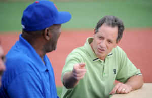 Ken Walsh, executive director of the Alfond Center, introduces former big league relief pitcher Lee Smith, left, during a Fran Purnell Wrigley Field ceremony Wednesday in Waterville.