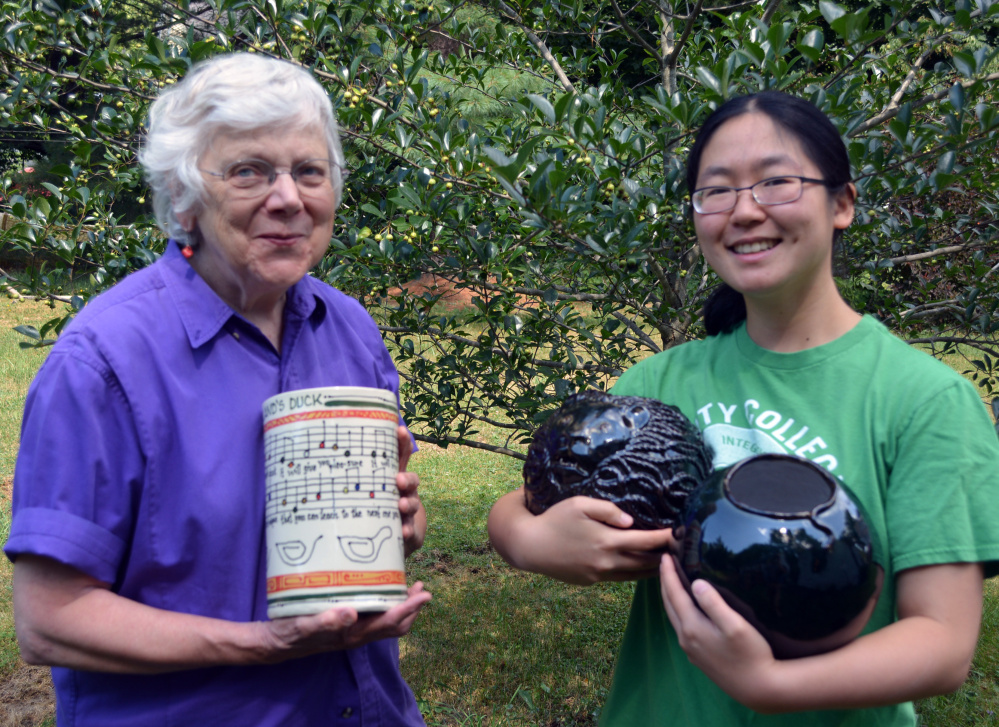 Image of Barb Loken, left, and Ru Allen with current works.