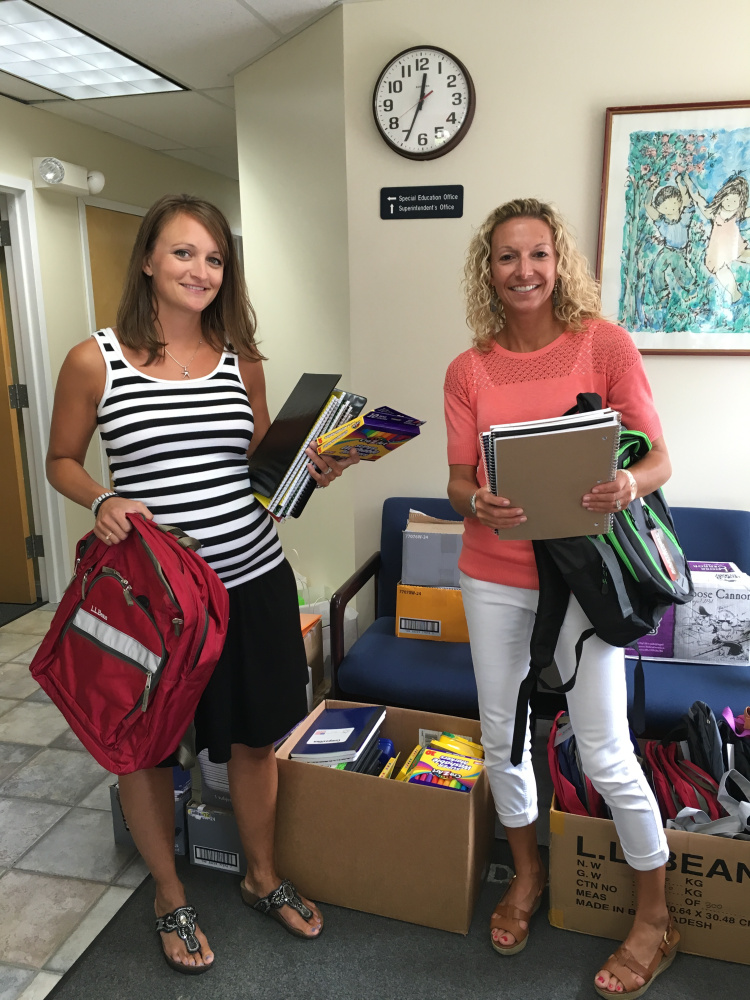 "Mallorie Hersom, left, and Angie Dooley, both guidance counselors at MSAD 49, helped with the United Way of Mid-Maine 2016 Summer of Caring ""Stuff the Bus"" Day of Caring event Aug. 17."