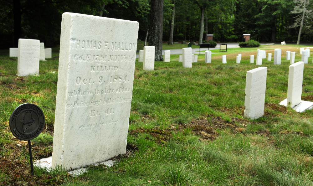This Aug. 17 photo shows grave marker for Kennebec County Sheriff's Deputy Thomas F. Malloy in the Togus National Cemetery. Malloy, a Civil War veteran, was killed in the line of duty in 1884 during a crackdown on rampant illegal liquor business in the area.