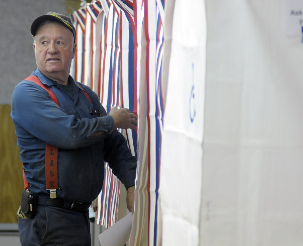 Gregory Larrabee heads into the polls June 14 voting in Litchfield, where voters twice have rejected the proposed Regional School Unit 4 budget.
