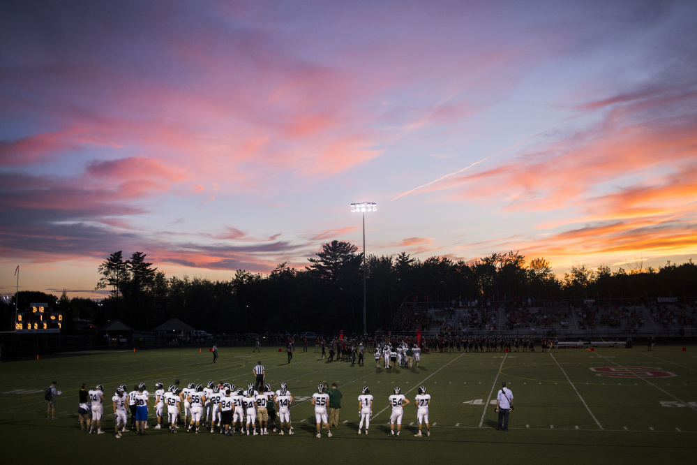 A sunset serves as a backdrop to the Bonny Eagle-Scarborough game Friday night. Bonny Eagle won 21-7.