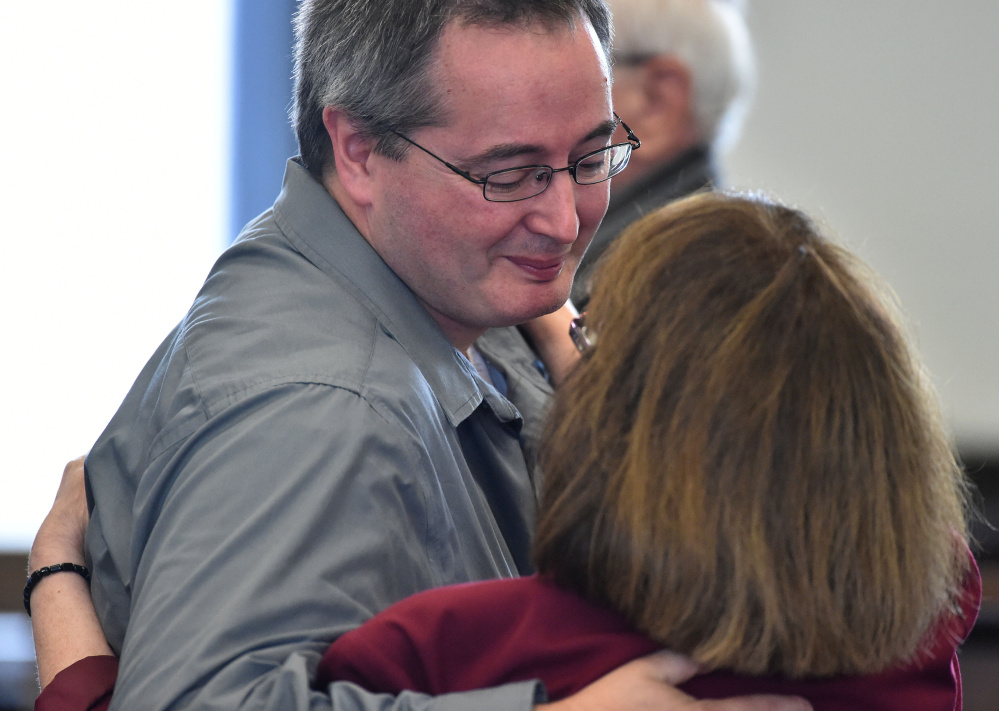 Dan Viles comforts his mother, Claudia, after her sentencing Sept. 2 at Somerset County Superior Court in Skowhegan.