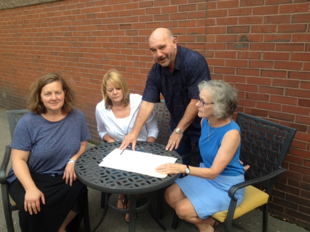 Members of a Skowhegan area business group will travel to Quebec City on Monday for three days of tours of bakeries, breweries and grist mills for possible collaboration. At work planning the tour Thursday were, from left. Amber Lambke, Pam Powers, Jon Kimbell and Jeane Shay.