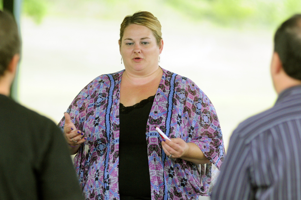 Shannon Hamilton, of Augusta, speaks during The Addict's Mom Light of Hope event Saturday in Mill Park in Augusta.