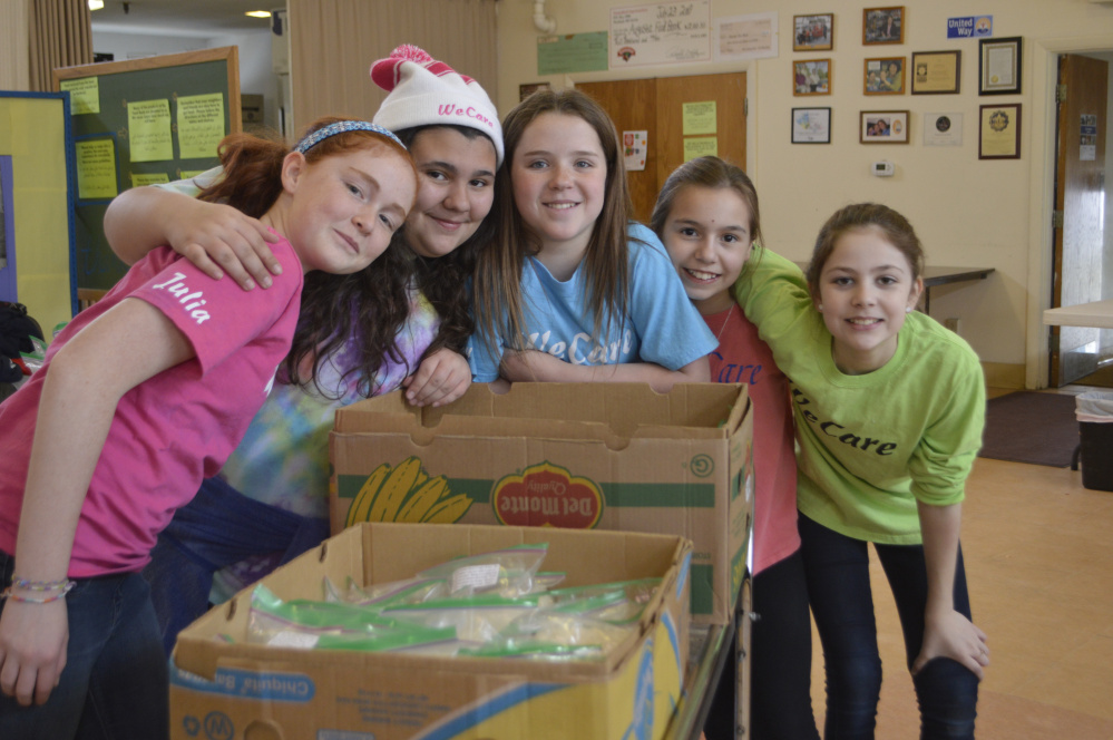 WeCare members recently volunteered at the Augusta Food Bank. From left are Julia Riley, Emma Draper, Shelby Cahill, Katryn Dubois and Maddie Lindquist.
