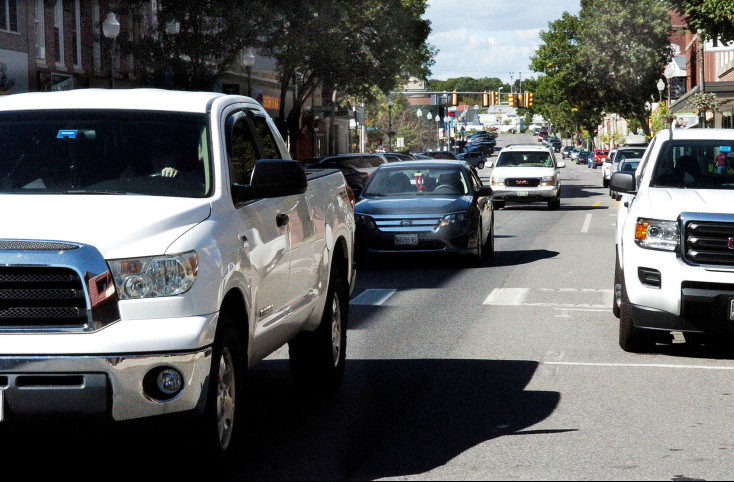 Traffic moves down Main Street in Waterville on Monday. A study that includes a proposal to return the street to two-way traffic has been sent to the state Department of Transportation and will likely go before the public next month.