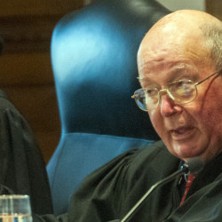 Justice Donald G. Alexander asks a question on Tuesday during oral arguments before the Maine Supreme Judicial Court in an appeal of the Eric Bard case in the ceremonial courtroom attached to the Capital Judicial Center in Augusta.