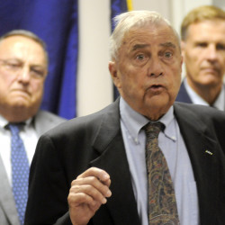 Public Safety Commissioner John Morris, flanked by Gov. Paul LePage, left, and Brig. Gen. Douglas A. Farnham, right, encouraged citizens Tuesday to call police if they see something suspicious.