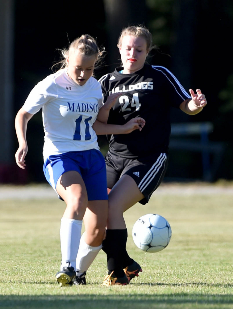 Madison junior Caitlyn Morgan (11) battles for the ball with Hall-Dale sophomore Kayla Searles during a Mountain Valley Conference game Tuesday afternoon. Madison won, 6-0.