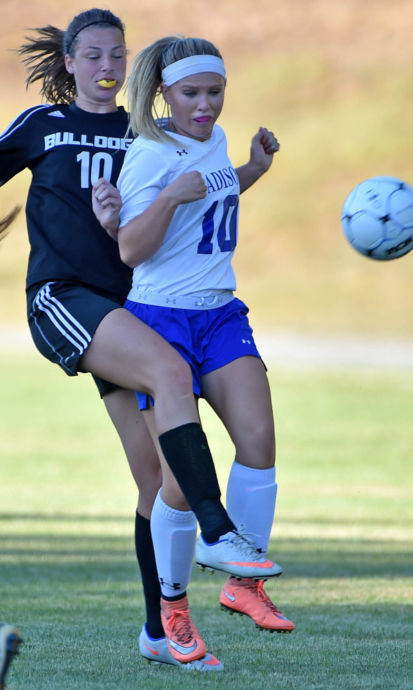 Madison senior Madeline Wood, front, battles for the ball with Hall-Dale sophomore Olivia Bourque during a Mountain Valley Conference game Tuesday afternoon.