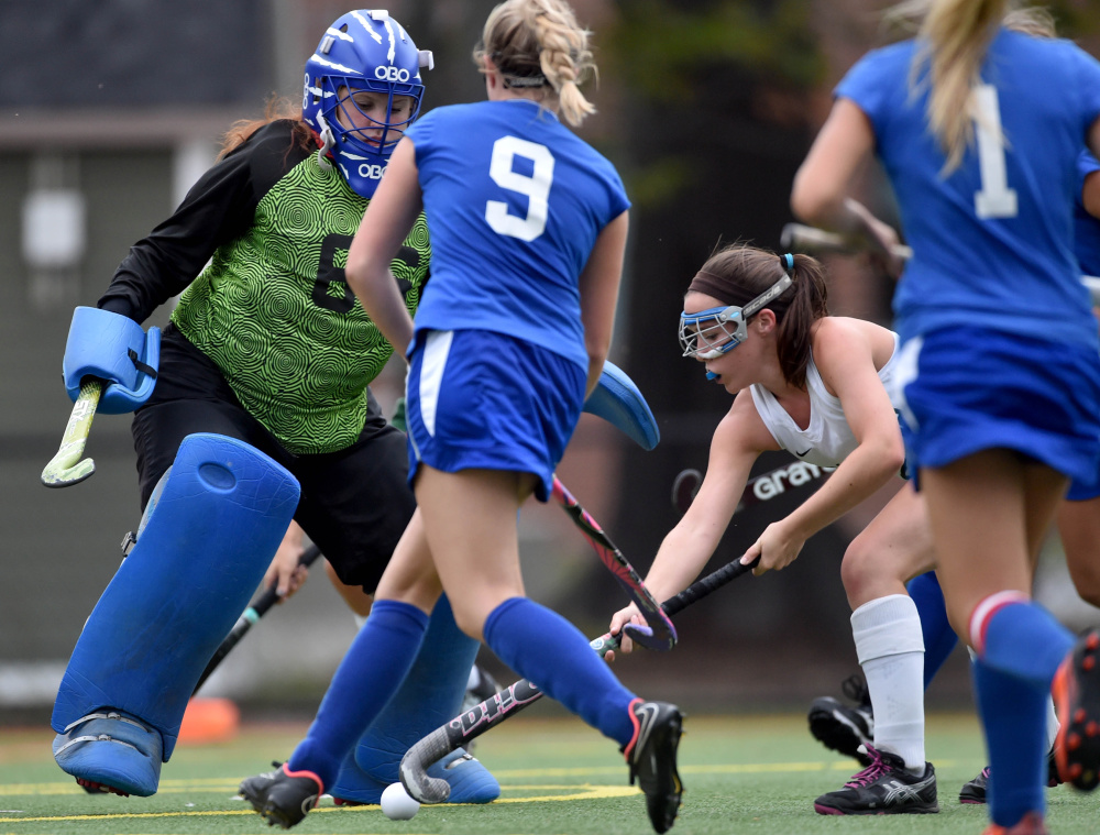 Winthrop sophomore Moriah Hajduk, right, tries to score on Oak Hill High School goalie Haley Salger during a Mountain Valley Conference game Wednesday at Thomas College in Waterville.
