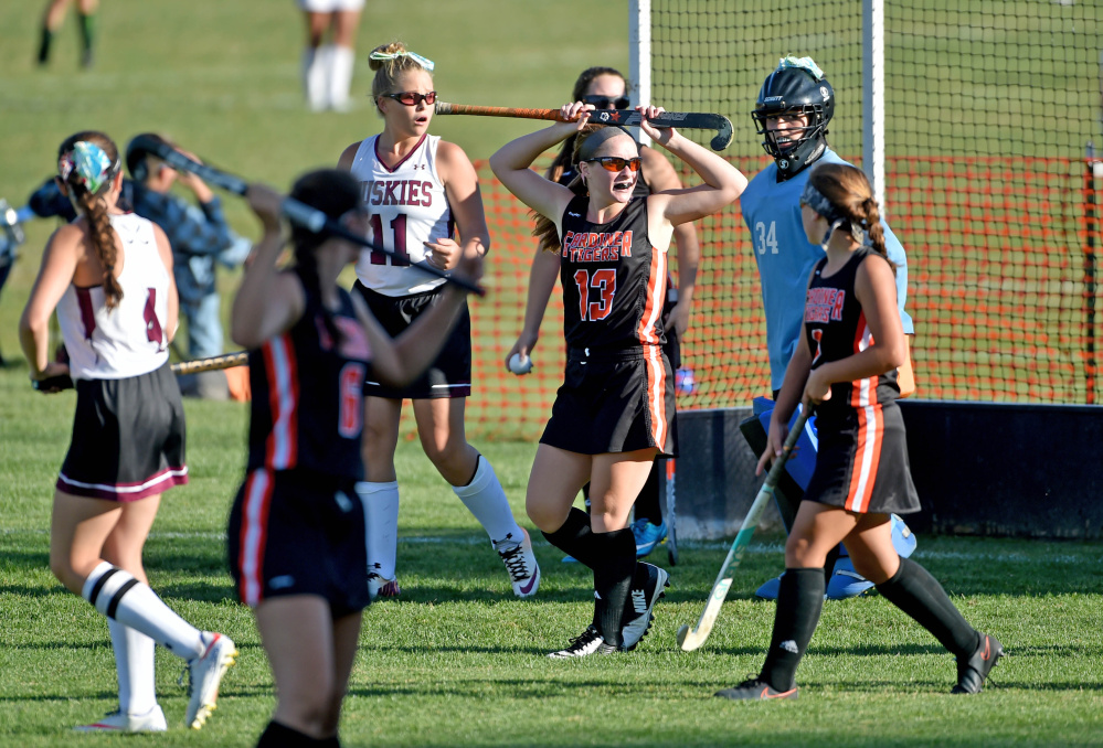 Gardiner's Hailee Lovely (13) holds her stick over her head as she waits for the official word on her goal against Maine Central Institute on Thursday in Pittsfield.