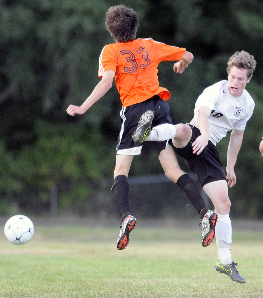 Maranacook's Max McQuillan, right, heads the ball as Winslow's Max Spaulding defends Thursday in Readfield.