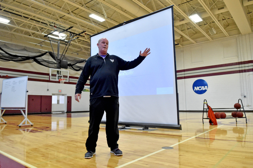 Steve Clifford, head coach of the Charlotte Hornets, speaks to area basketball coaches during a coach's clinic Saturday at Dearborn Gymnasium in Farmington.