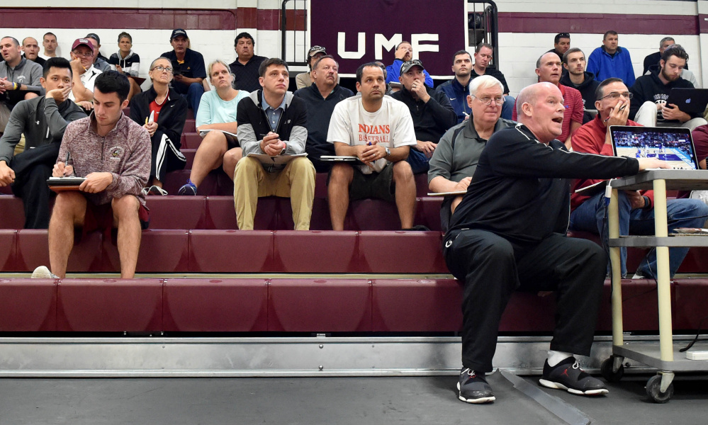 Steve Clifford, far right, head coach of the Charlotte Hornets, uses video for instruction during a coach's  basketball clinic Saturday at Dearborn Gymnasium in Farmington.