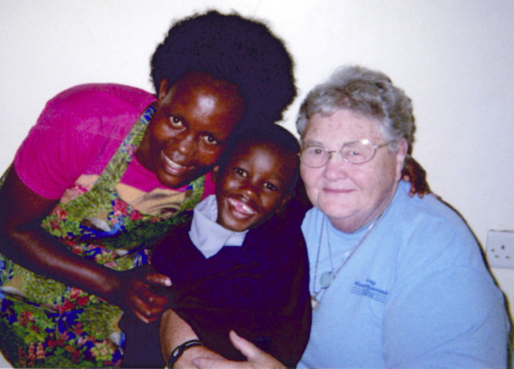 Betsy Drumm, right, is with the boy she sponsors, Arthur, 6, and a volunteer, Mary, in Kenya.
