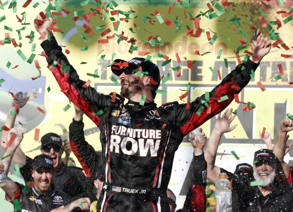 Martin Truex Jr., celebrates with his crew in Victory Lane after winning a NASCAR Sprint Cup Series race Sunday at Chicagoland Speedway in Joliet, Illinois.