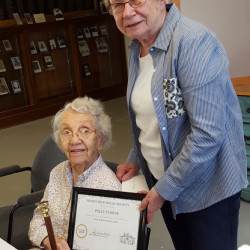 SIDNEY — The Boston Post cane was presented to Polly Furber, left, by Sidney Historical Society President Sally Nelson. Furber, 96, who has lived for some time in a historic house in Sidney, is the oldest resident of the town. Furber has given the society countless hours of her time researching deeds.