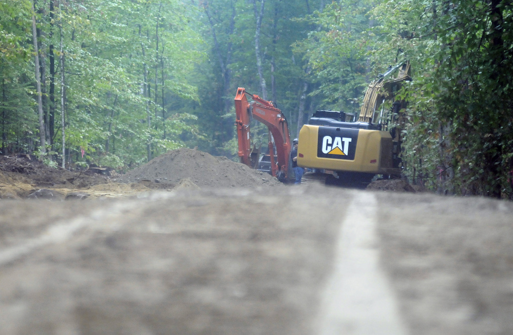 Excavators build a new road Monday at the Jamies Pond Wildlife Management Area in Manchester. Logging crews are harvesting wood at the 840 acre parcel of land managed by the Department of Inland Fisheries and Wildlife.