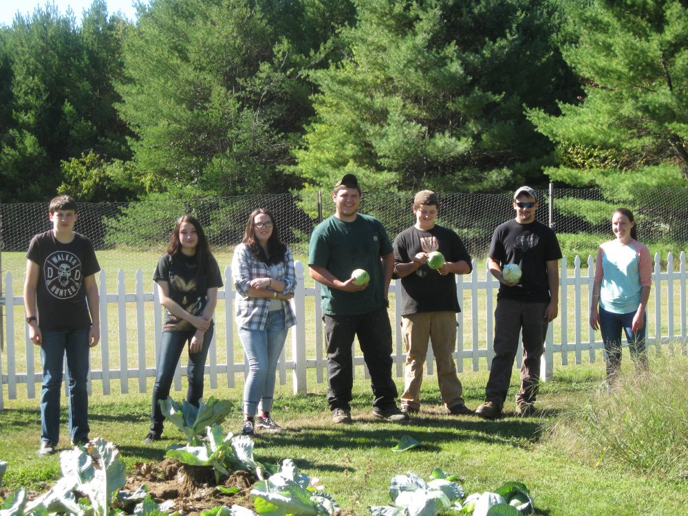 A group of six students and an instructor from the Maine Academy of Natural Sciences in Hinckley volunteered their time to help Cedar Ridge Center in Skowhegan to close up portions of their vegetable garden. From left, are Kolby Hibbard, Gabriel Lindsay, Izabel Wyman, Darrin LeBarge, Brennen Boulette, Peter Rotondi and MeANS Social Studies Teacher Jessica Parker.