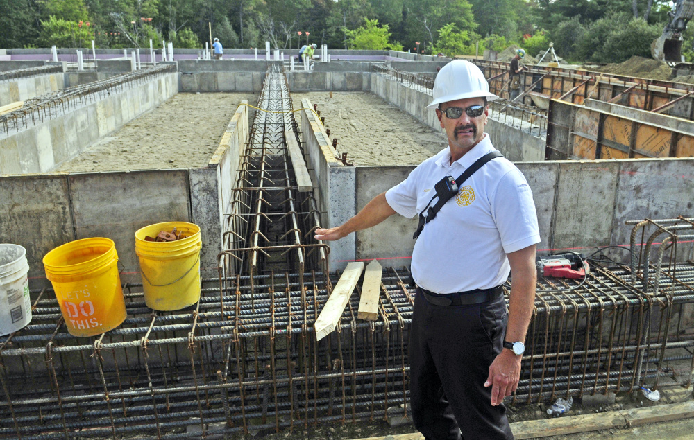Augusta Fire Chief Roger Audette talks about the foundation of the new fire station being built on Leighton Road in Augusta during a tour of the property Tuesday afternoon.