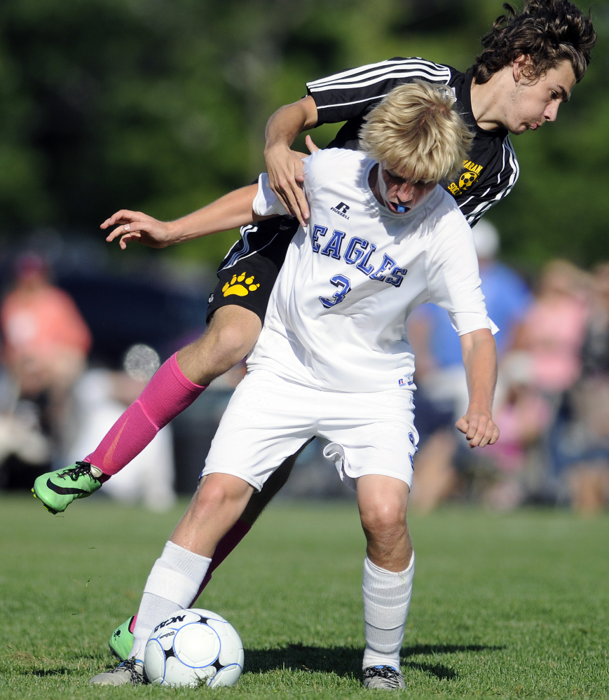 Maranacook senior defender Dennis Chiappetta collides with Erskine's Caleb Tyler during a Class B game Tuesday in South China.