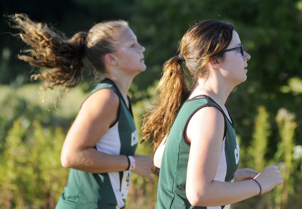 Carrabec High School's Samantha Taylor, right, and Nevaeh Burnham compete in a Mountain Valley Conference cross country meet Wednesday  in Augusta.