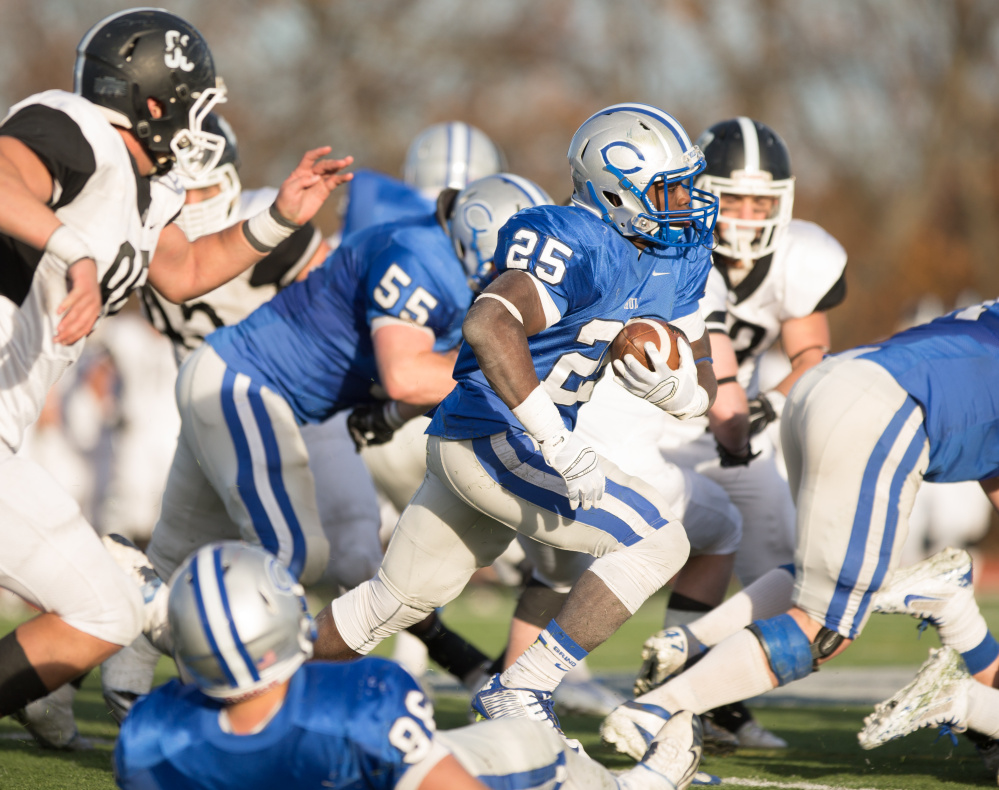 Jabari Hurdle-Price, of Colby College, runs the ball during a NCAA Division III football game in Waterville.