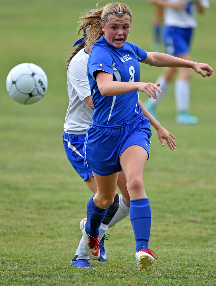 Oak Hill High School's Rylea Mae Swan (8) chases down the ball in Madison on Thursday.