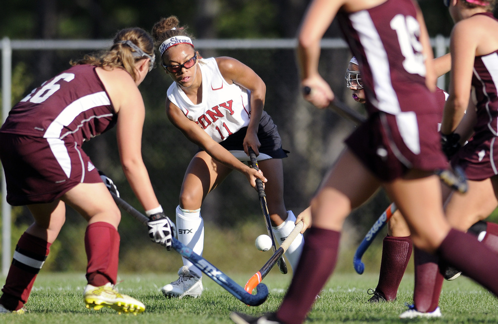 Cony's Kami Lambert passes through Edward Little's defense during a game Thursday in Augusta.