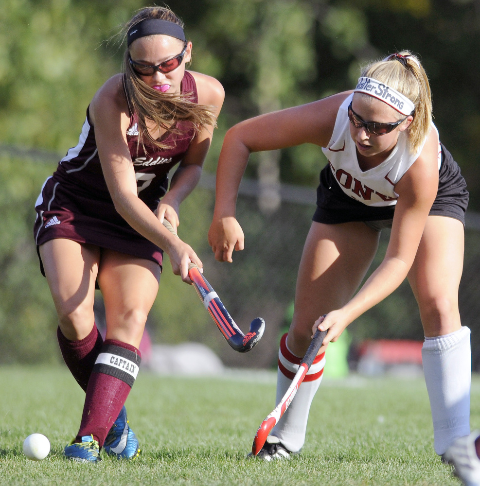 Cony's Delaney Keithley, right, passes around Edward Little's Kayla Vallee during a game Thursday in Augusta.