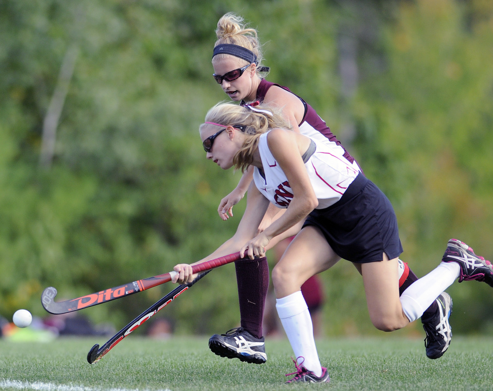 Cony's Sophie Whitney, front, drives past Edward Little's Grace McBride during a game Thursday in Augusta.