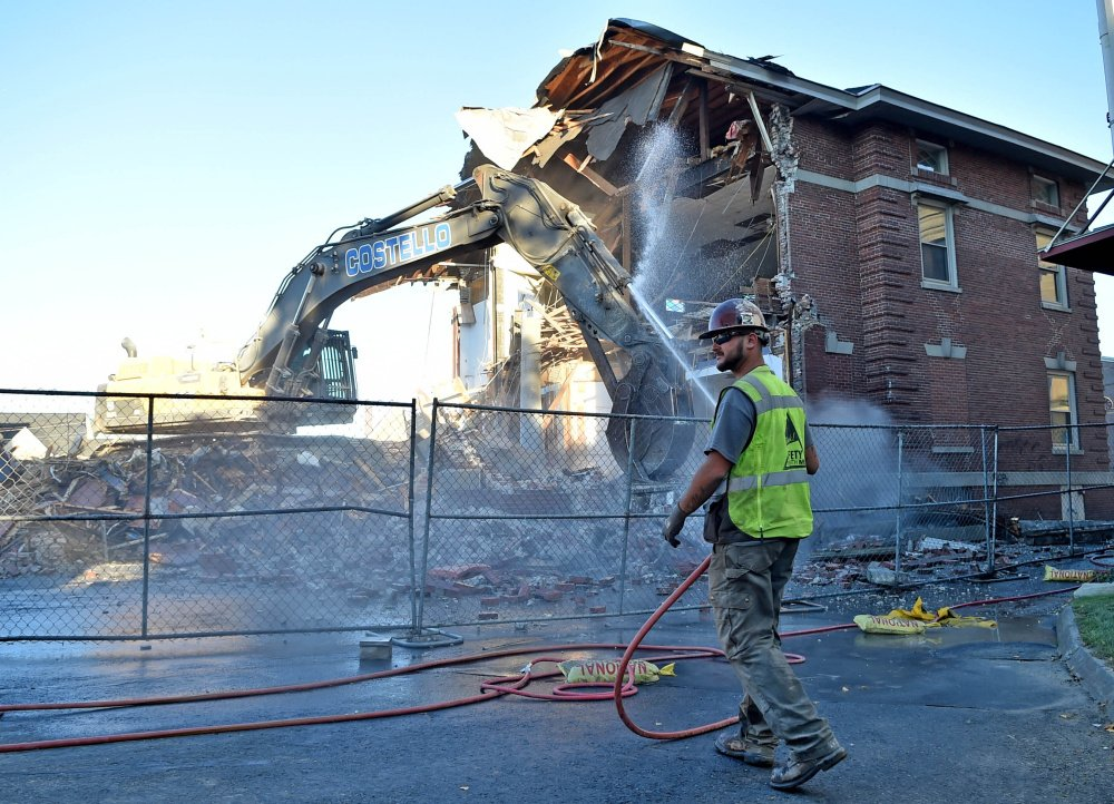 Construction crews with Costello Dismantling Company demolish the former Elks building on Appleton Street in Waterville on Sept. 13.