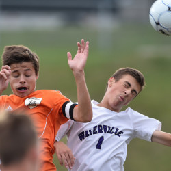 Winslow's Spencer Miranda, left, battles for the ball with Waterville's Nicholas Dufour on Friday in Waterville.