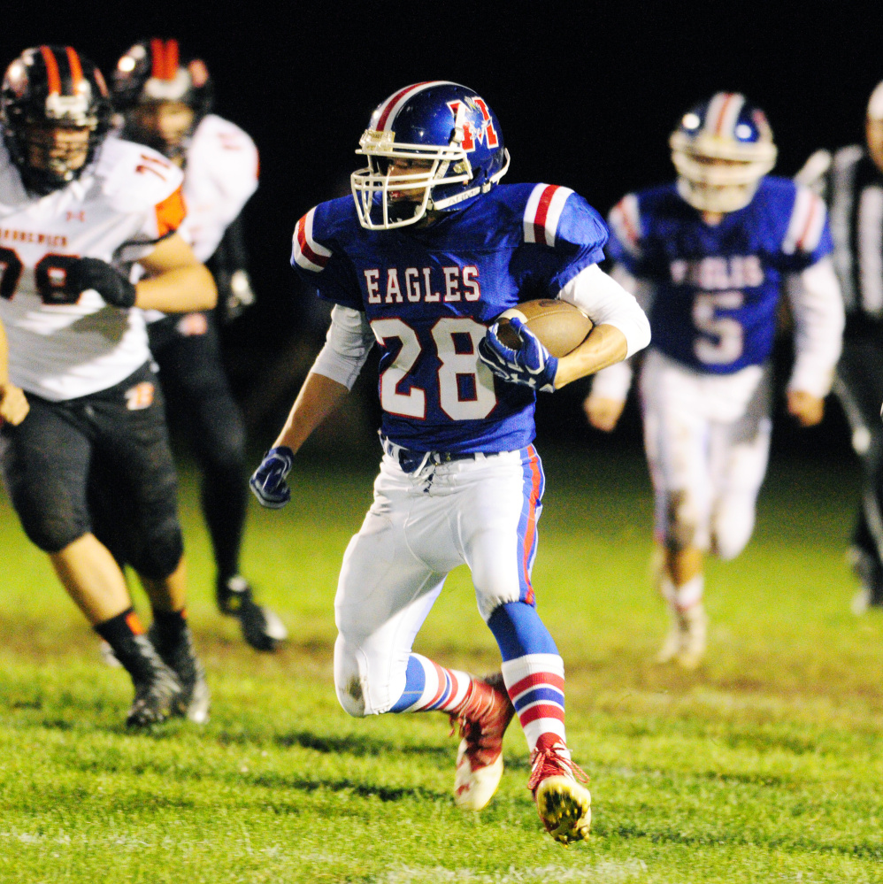 Messalonskee's Tyler Lewis runs the ball during a Pine Tree Conference Class B game against Brunswick on Friday at Veterans Field in Oakland.