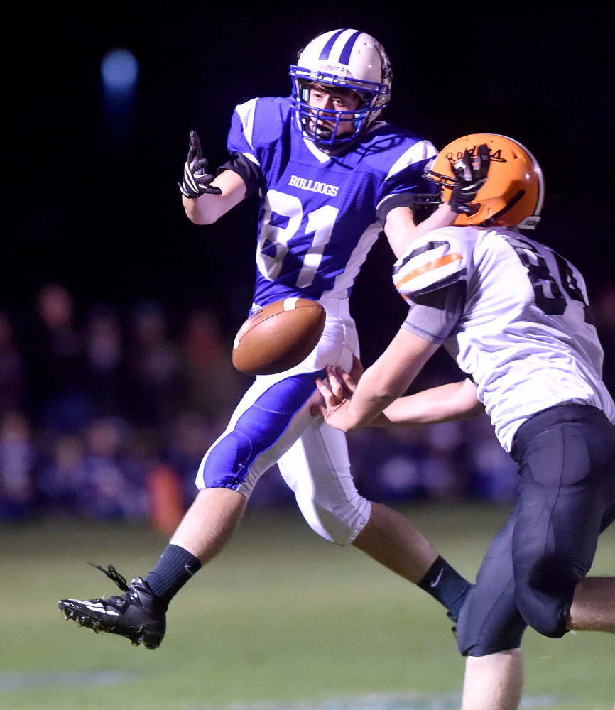Madison receiver Steven Ouellette (81) can't make the catch as Winslow's Hunter Campbell defends Friday night.