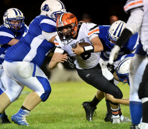 Winslow quarterback Ryan Gagnon gets sacked by a swarm of Madison defenders during a Big Ten Conference game Friday night in Madison.