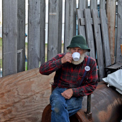 Tom Kemp takes a break from the action during his volunteer time at the Common Ground Country Fair in Unity on Saturday.