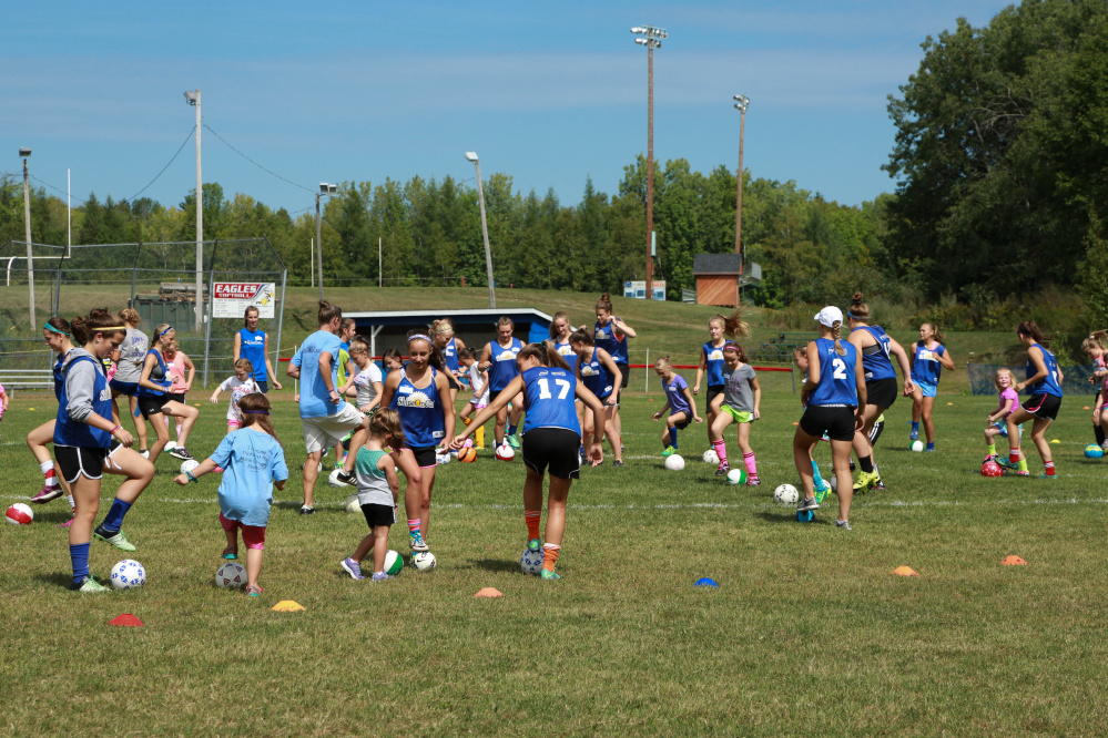 Messalonskee girls soccer and area youth girls take the field at the first Shine On Saturday in honor of Cassidy Charette in Oakland.