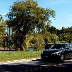 Traffic passes at the intersection of Armstrong Road and Washington Street in Waterville near the Colby College campus in Waterville on Monday. Todd Michaud reported that Donald Trump signs he placed on the public right-of-way were stolen over the weekend.