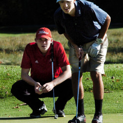 Messalonskee junior Jacob Bouchard, right, and Cony junior Tyler Dostie eye Bouchard's shot during a Kennebec Valley Athletic Conference Class A Central match Monday at Natanis Golf Course in Vassalboro.