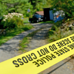 Police tape marks off the driveway to the Tieman residence at 628 Norridgewock Road in Fairfield on Sept. 20. Authorities say they discovered the body of Valerie Tieman in the woods and an autopsy showed she was shot twice in the head. Her husband, Luc Tieman, has been charged with murder in connection with the death.