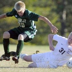 Richmond's Adam Beaulieu, right, falls down while chasing after the ball with Rangeley's Nathan Van Buren on Tuesday in Richmond.