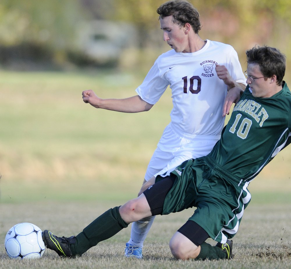 Richmond's Brady Johnson and Rangeley's Bo Beaulieu collide while going after the ball Tuesday in Richmond.
