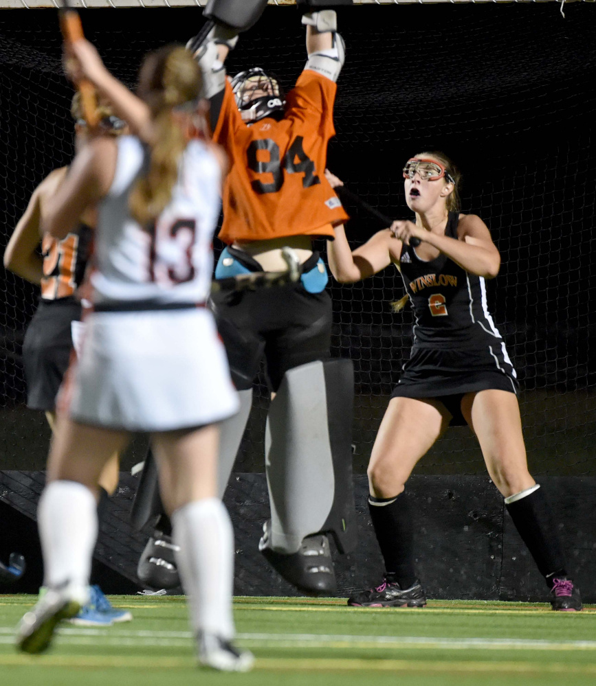 Winslow goalie Hope Winkin (94) leaps to make a save unsuccessfully on a loft shot by Gardiner's Hailey Lovely (13) Tuesday at Thomas College in Waterville.